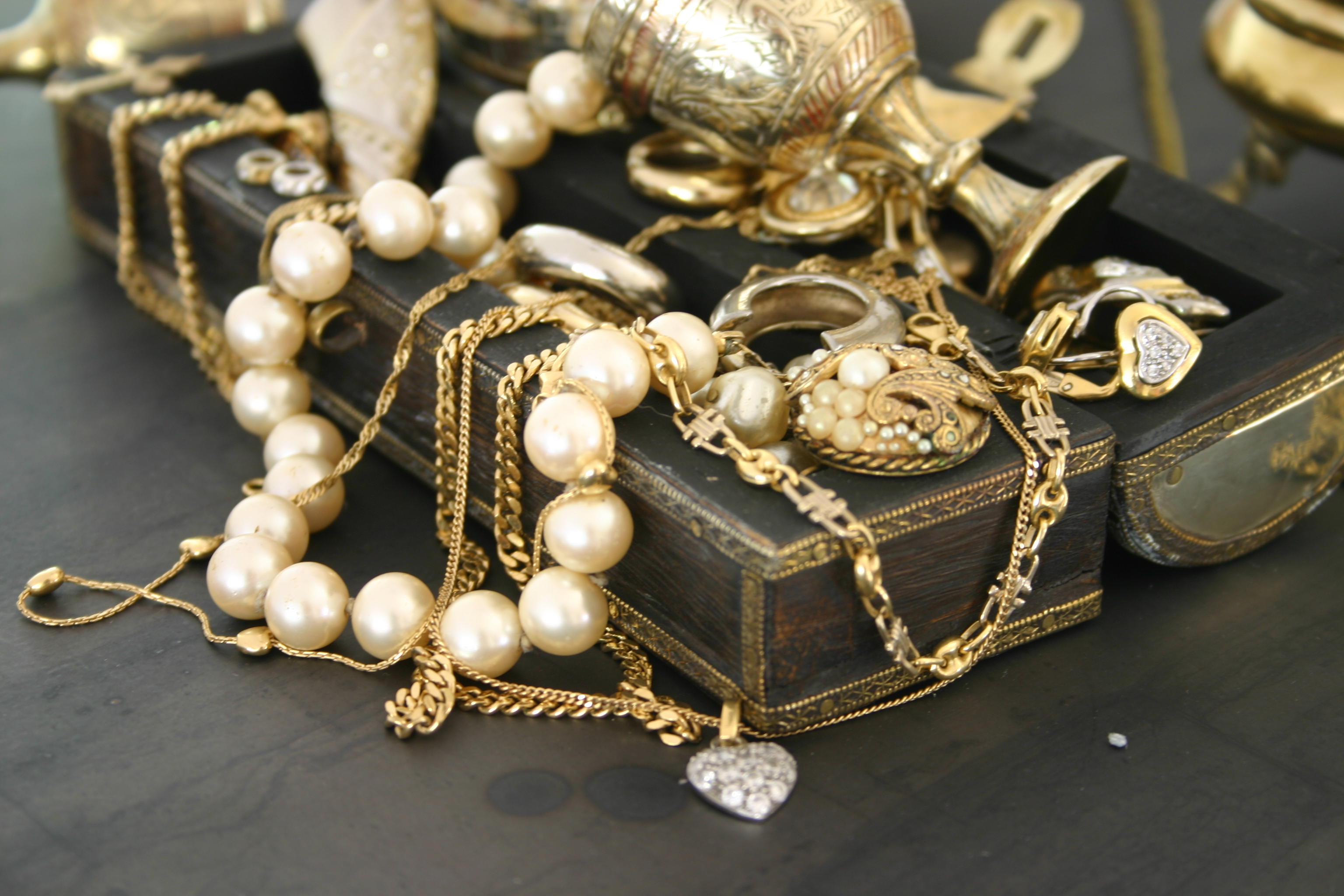 Jewelry laying over an indian jewelry box.See similar pictures: Jewelry: